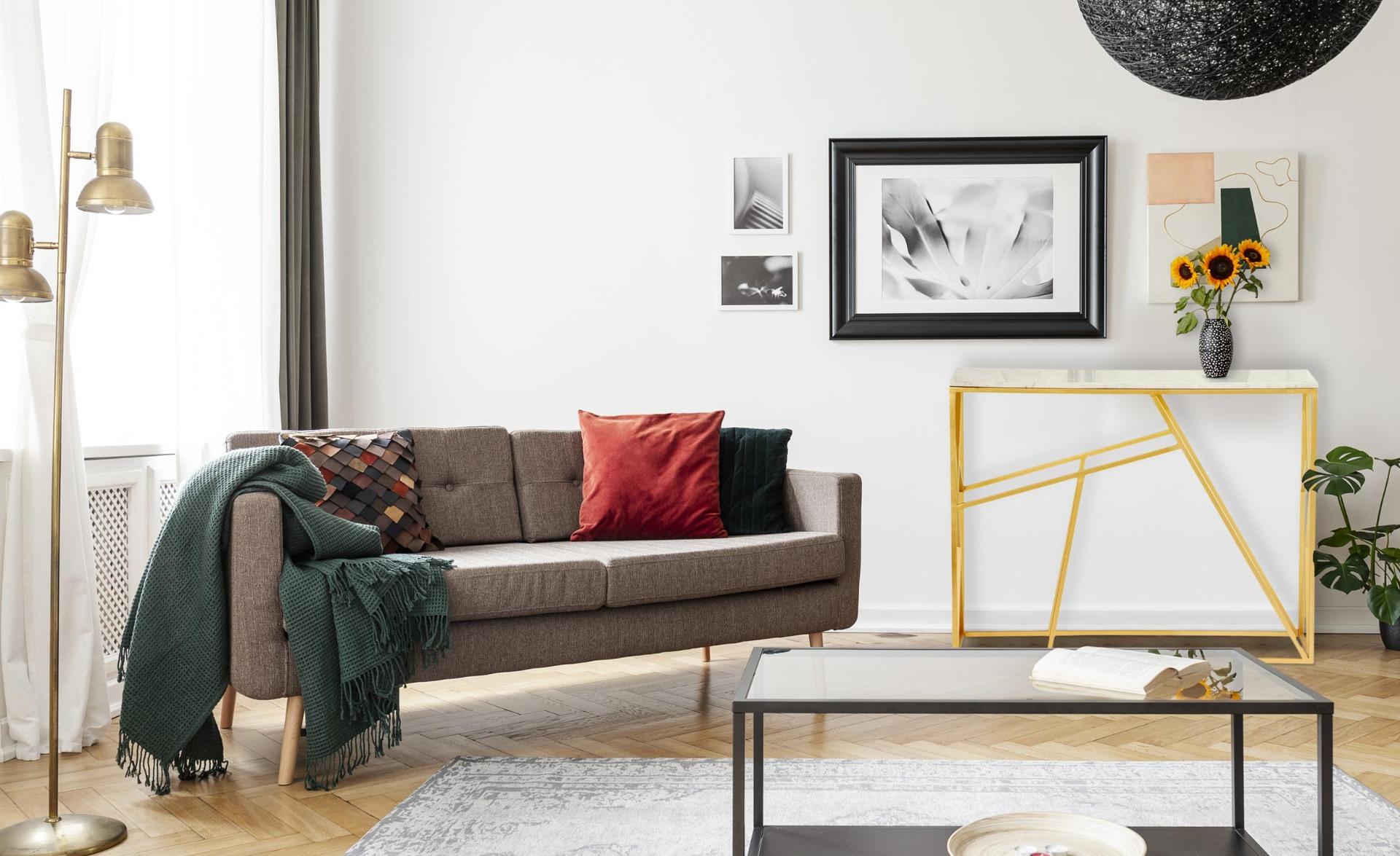 Console di design Puzzle in marmo e metallo dorato